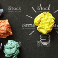 Inspiration concept crumpled paper light bulb metaphor for choosing the best idea